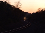 NS coal train 524 is eastbound entering the cut in the late evening